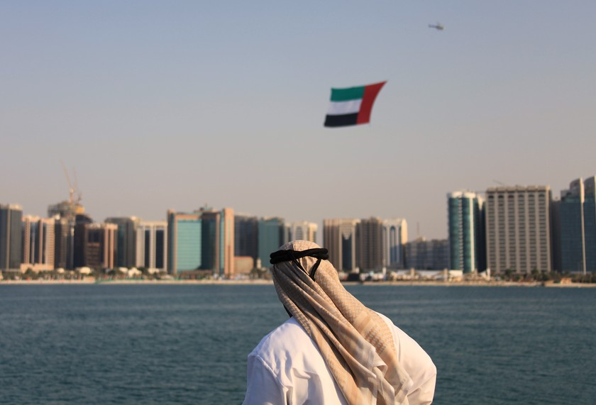 Emirati Man helicopter flag over Abu Dhabi UAE