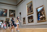 Louvre museum Paris France tourist attractions paintings attract woman