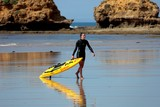 Surf Life Saving Australia girl with paddle board beach