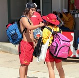 Surf Life Saving Australia largest lifeguard service young couple surf rescuer