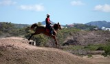 Stockman on his horse Koumac New Caledonia Stock race
