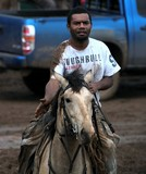 Black men on a horse New Caledonia Rodeo cowboy stockman