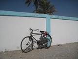Bike on the wall Dibba town pictures Sultanate of Oman
