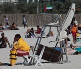 Lifeguard supervises the safety and rescue of swimmers, surfers Abu Dhabi beach