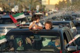 childrens on the car national day abu dhabi UAE car on the corniche abou dabi fete nationale