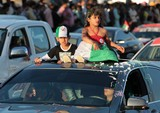 girl and boy top of the car abu dhabi national day 40th anniversary UAE fete nationale