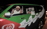 green car abu dhabi corniche 40th anniversary national day men smilling