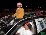 children top of the car national day abu dhabi 40th anniversary UAE