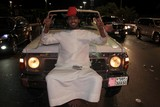man sit on the front of is car national day abu dhabi corniche 40h anniversary