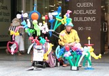 Queen Adelaid Building old man with balloons