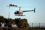 Helicopter Robinson R44 take off New Caledonia flying scenic tour pictures photographer