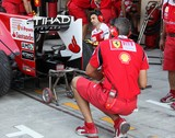 Mechanics and Engineers Ferrari stand Pit lane Abu Dhabi Grand Prix Formula 1 Emirats Arabes Unis